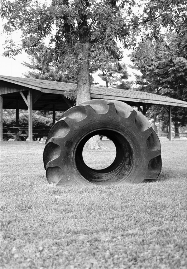 Play tire in park giving depth.