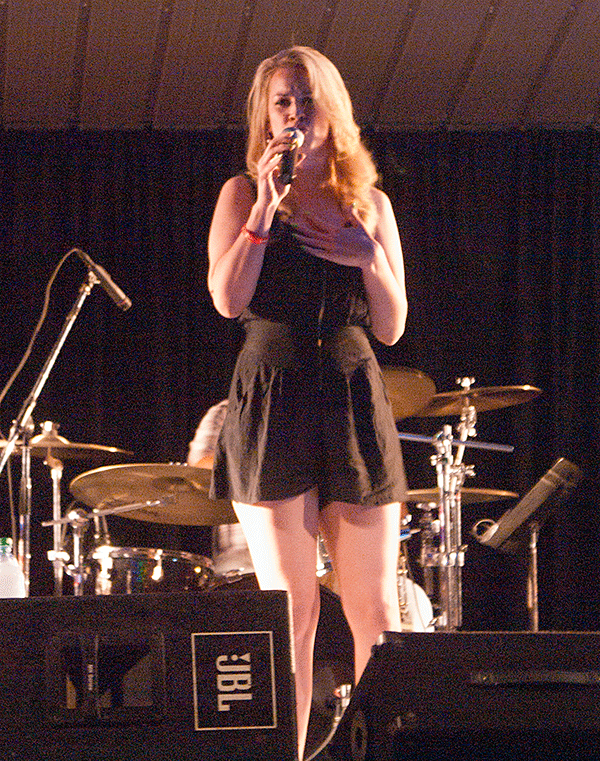 Photo of Kasey Lansdale performing at Farmer City